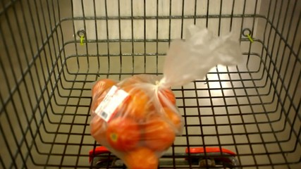 Customer shopping at supermarket with trolley. Video shift