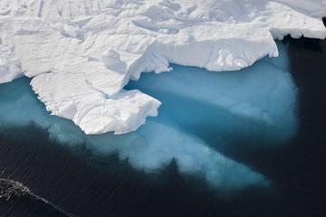 Antarctica blue iceberg floating