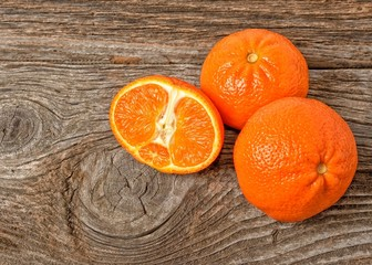 fresh oranges on a wooden background
