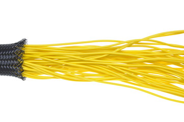 Yellow electrical wires in protection tube on white background