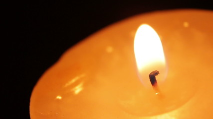 Burning a candle extreme closeup footage