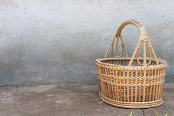 Rattan basket on the cement floor