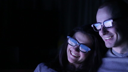 Happy, Excited Couple Watching 3D Movie at home