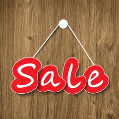 Sale sign on wood texture