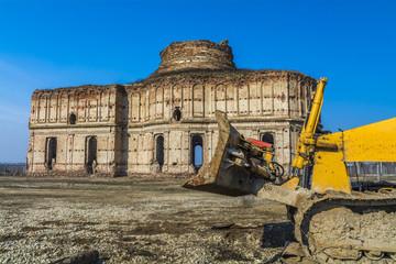 Ancient church ruins beeing demolished