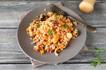 Delicious pilaf with peppers, carrots and tomatoes