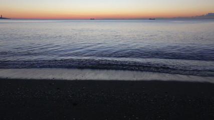 Sunrise view of Mediterranean sea and sand beach