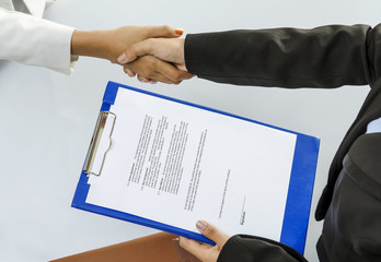Business person handshaking for contract deal