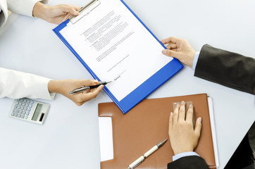 Business person about to sign contract
