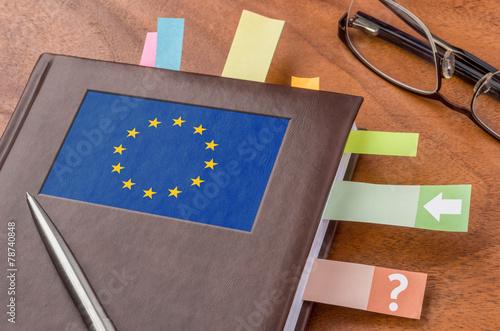 Leinwanddruck Bild Terminkalender mit der Flagge der EU