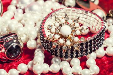 lot of jewellery close up in red velvet box, ring bracelet