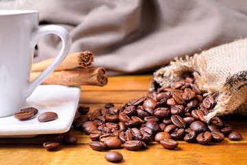 Cup of coffee on a brown wooden table front view