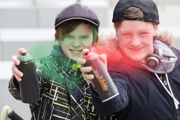 Two boys spray painting