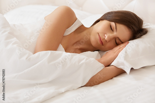 Leinwanddruck Bild Young Beautiful Woman Sleeping on Bed
