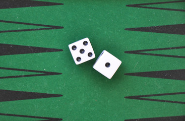 two dice on a green gaming table.