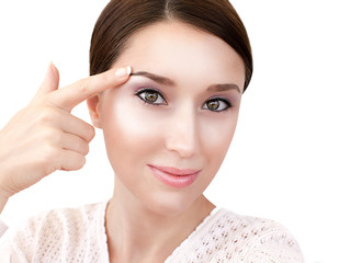 Woman's face with dewy skin make up