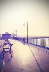 Retro vintage filtered nostalgic promenade with lens flare.