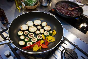 Grilling fresh vegetables on frying pan