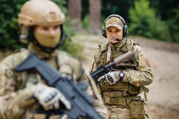 Two soldiers scout the area occupied by the enemy