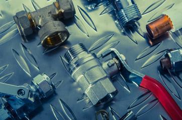 Plumbing Kit on a metal surface. Toning