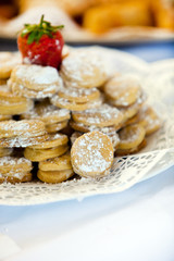 Gourmet Delicious Macarons with Sugar on a Plate