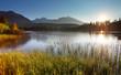 Sunset on mountain lake - Strbske pleso in Slovakia.