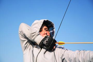 Boy aiming a bow