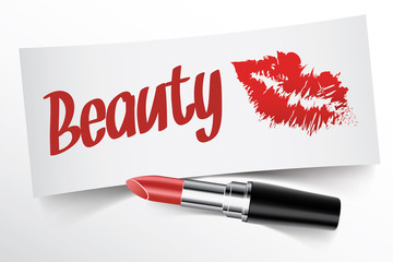 Beauty written on note by lipstick with kiss