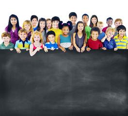 Multi-Ethnic Group Children Empty Blackboard Concept