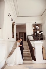 Bride and groom in a white palace