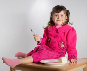 Little girl eating dessert