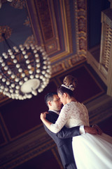Bride and groom in a palace