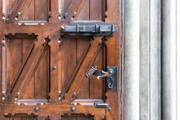 Old wooden door with wrought iron handle