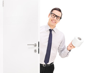 Cheerful businessman bringing toilet paper