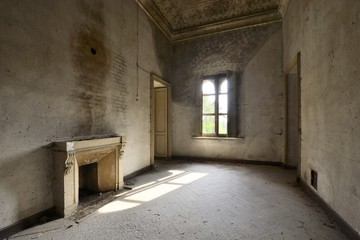 old abandoned room with window and fireplace