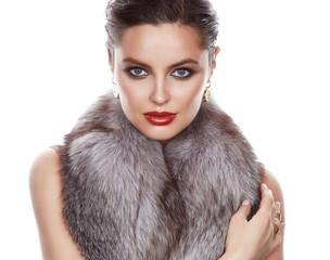 Beautiful sexy woman in furs makeup makeup jewelry