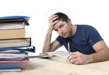young student studying on library for exam in stress