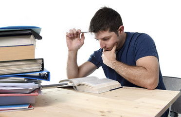 young stressed student studying for exam in stress