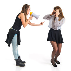 Girl shouting at her sister by megaphone