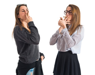 Twin sisters smoking