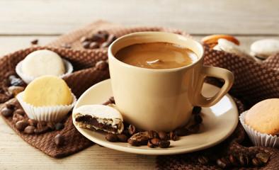 Gentle colorful macaroons and  coffee in mug