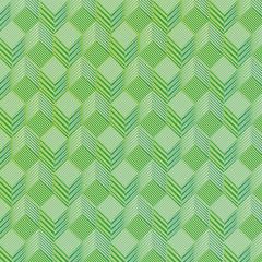 Grüne Würfel auf einem Stoffmuster