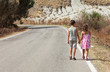 portrait of two children on the road