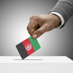 Black male holding flag. Voting concept - Afghanistan