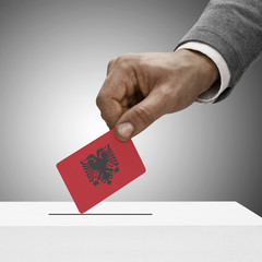 Black male holding flag. Voting concept - Albania