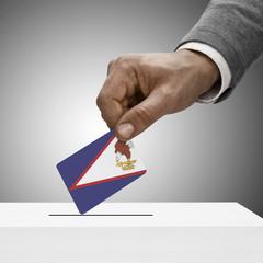 Black male holding flag. Voting concept - American Samoa