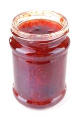 Homemade jar of strawberry jam isolated on white background