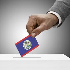 Black male holding flag. Voting concept - Belize