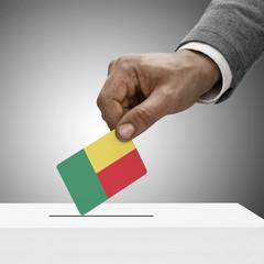Black male holding flag. Voting concept - Benin