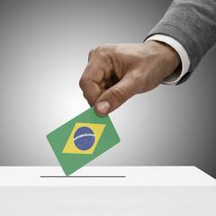 Black male holding flag. Voting concept - Brazil